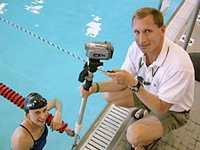 Pete Sczupak and swimmer with video equipment